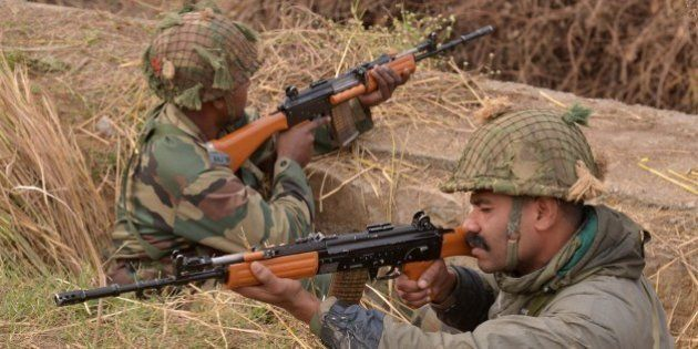 Indian army soldiers take up position on the perimeter of an airforce base in Pathankot on January 4,...