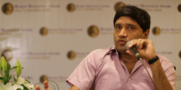 Ramon Magsaysay awardee Indian Sanjiv Chaturvedi, an anti-corruption campaigner, gestures as he answers...