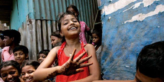 Slumdog Millionaire child star Rubina Ali plays with her friends at a shanty town in Mumbai, India, Saturday,...