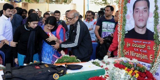 E.K. Sivaranjam (C), father of slain National Security Guard Bomb Disposal Squad personnel, thirty-four-year-old...