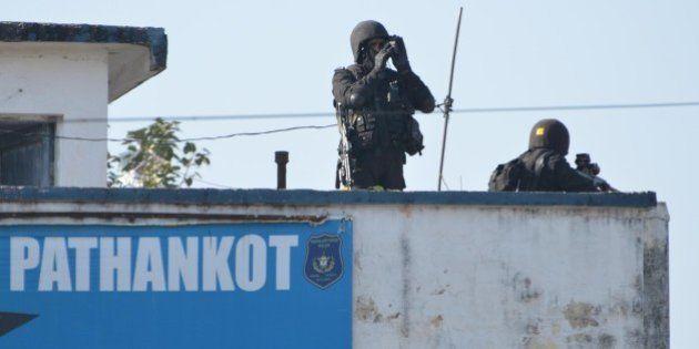 PATHANKOT, INDIA - JANUARY 5: Commandos stand guard at Air Base during combing operations at Pathankot...