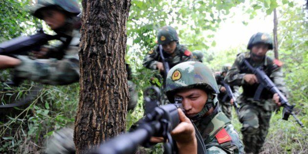TONGLING, CHINA - AUGUST 27: (CHINA MAINLAND OUT) Tongling armed police hold anti-terrorist manouvres...