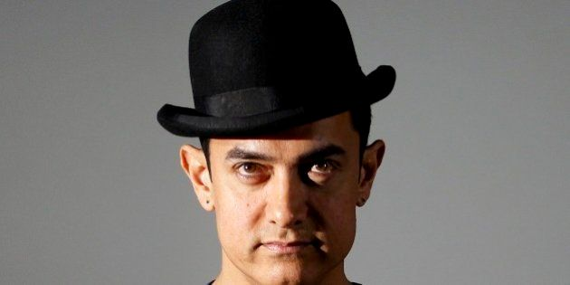 Bollywood actor Aamir Khan attends a trailer launch of his film Dhoom 3 in Mumbai, India, Wednesday,...