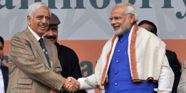 SRINAGAR, INDIA - NOVEMBER 7: Prime Minister Narendra Modi greets Jammu & Kashmir Chief Minister Mufti...