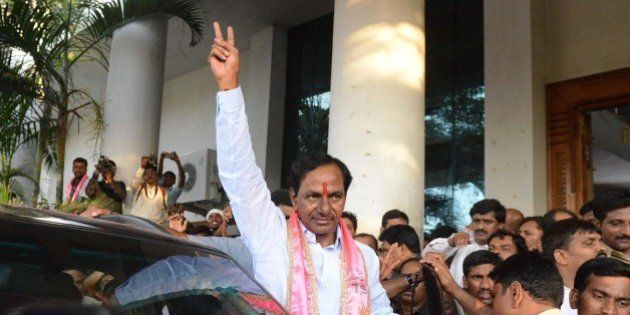 Indian Telangana Rashtra Samithi (TRS) party president K Chandrasekhar Rao (C) greets supporters at Telangana...