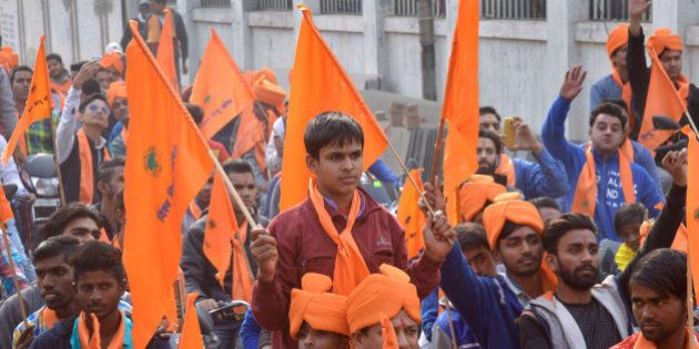 Indian activists of Hindu Bajrang Dal, along with Vishva Hindu Parishad (VHP) organizations, raise religious...