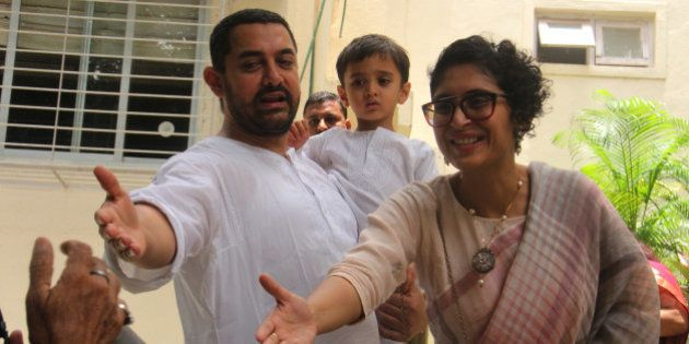 MUMBAI, INDIA - JULY 18: Bollywood actor Aamir Khan with wife Kiran Rao and son Azaad greets fans at...
