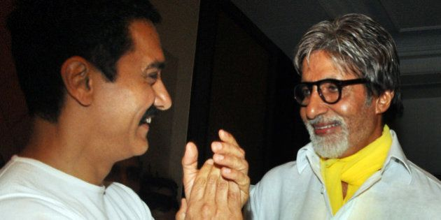 Indian Bollywood film actors Amitabh Bachchan (R) and Aamir Khan attend the tenth anniversary celebration...