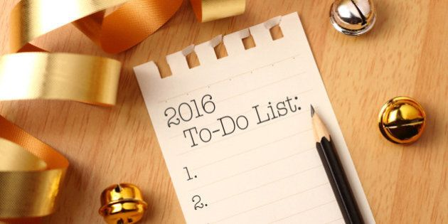 New Year's to-do list with gold color decorations. New Year's goals are resolutions or promises that...