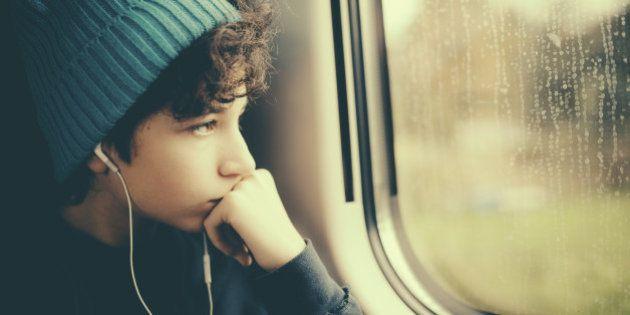 Pensive Girl on Train looking through