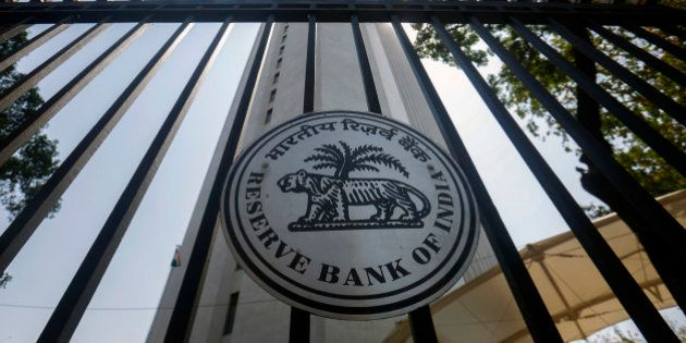The Reserve Bank of India (RBI) logo is displayed on a gate at the central bank's headquarters in Mumbai,...