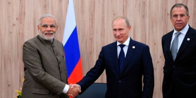 In this photo taken Tuesday, July 15, 2014, Russian President Vladimir Putin, centre, and Indian Prime...