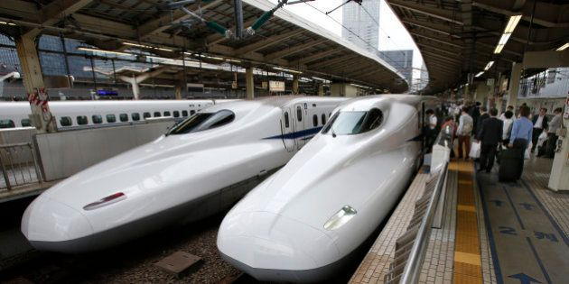 In this Sept. 24, 2014 photo, passengers get into the Shinkansen bullet train at Tokyo station in Tokyo....