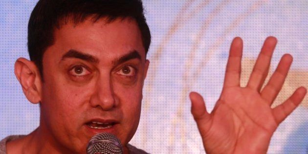 Bollywood actor Aamir Khan speaks during the unveiling of the second poster of his upcoming film PK in...