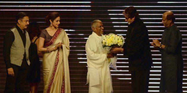 Bollywood film star Amitabh Bachchan (2R) felicitates music director Ilaiyaraaja (C) as film actors Sridevi...