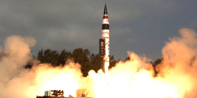 This photograph released by the Indian Ministry of Defense shows India's Agni-V missile, with a range...