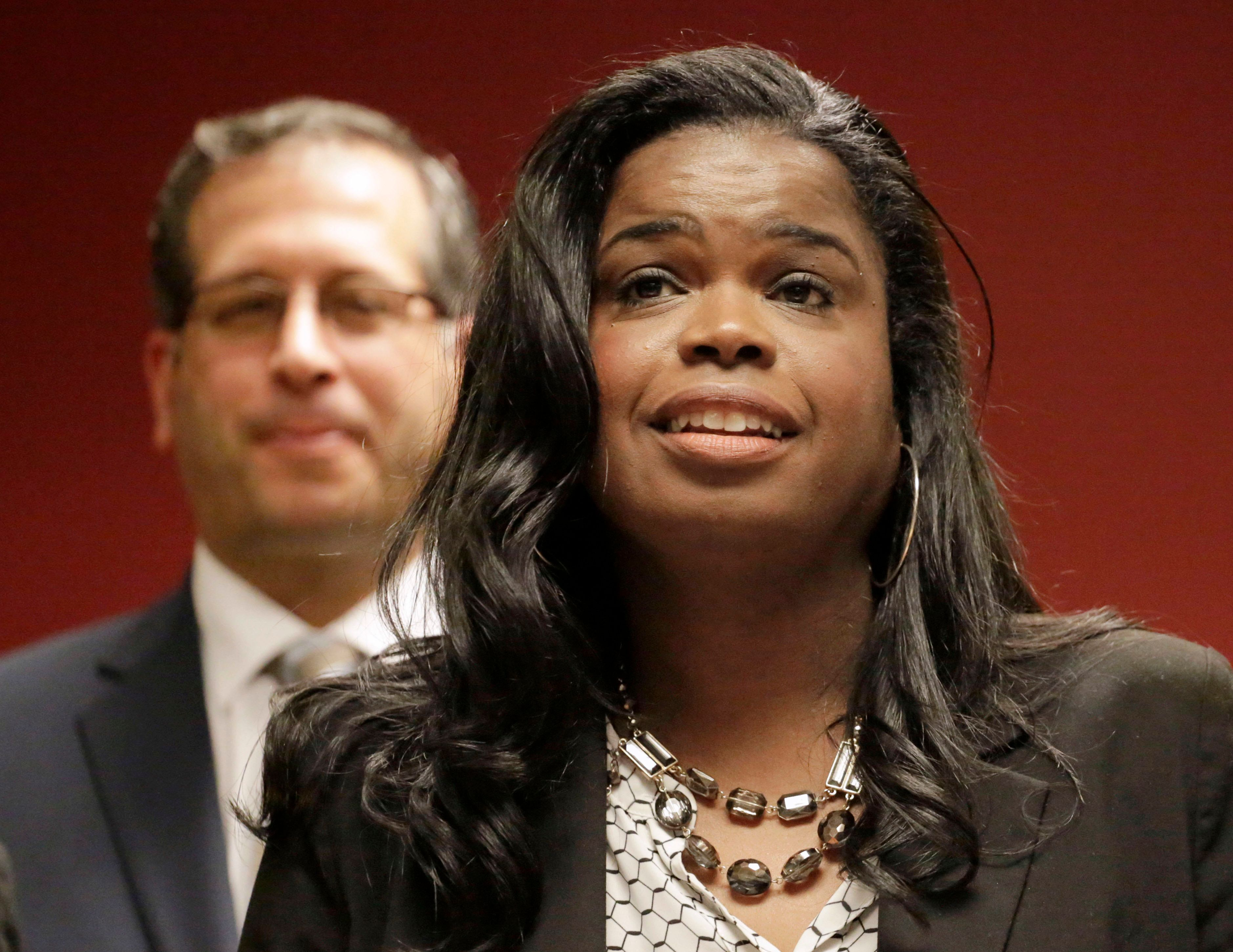 FILE - In this Dec. 2, 2015, file photo, Kim Foxx, then a candidate for Cook County state's attorney, speaks at a news conference in Chicago. Foxx, the Chicago area's top prosecutor says her office is starting a new effort to target gun crimes in city neighborhoods and revamping a branch of her office that investigates possible wrongful convictions. State's Attorney Foxx said Wednesday, March 15, 2017 that attorneys from her office are teaming up with federal prosecutors in two police districts that have some of the highest violence rates.(AP Photo/M. Spencer Green, File)