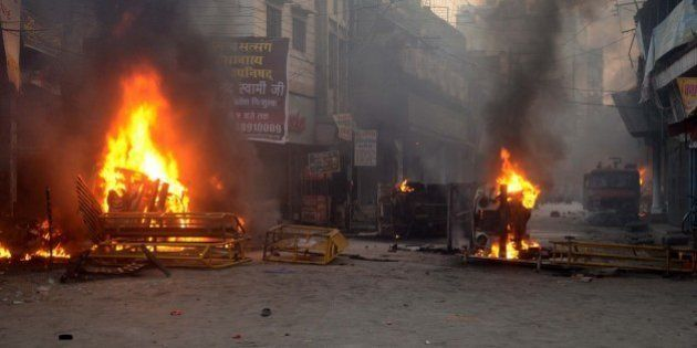 VARANASI, INDIA - OCTOBER 5: Vehicles set ablaze by angry mob in widespread violence and arson during...