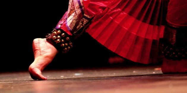 An Indian classical dancer's feet moving during her