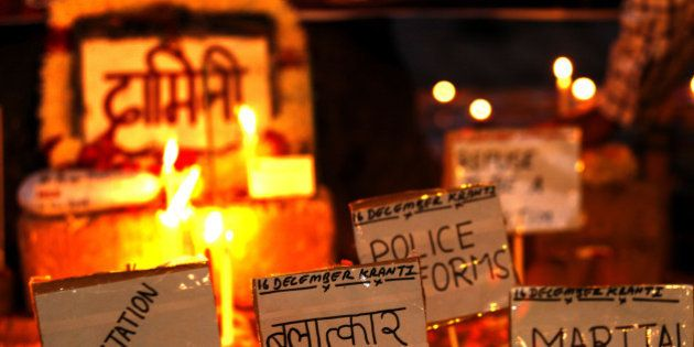 NEW DELHI, INDIA - DECEMBER 16: Placards against rape is pictured beside a memorial at the protestors...