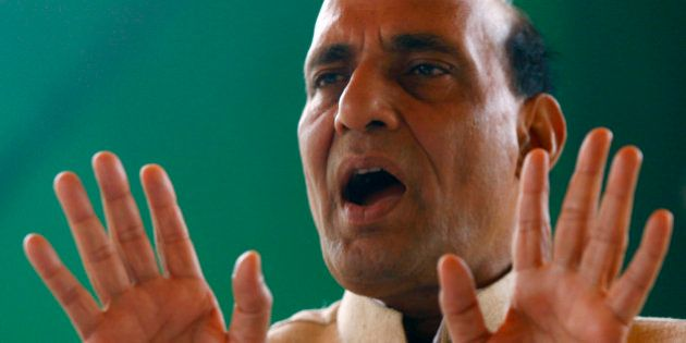 The President of India's main opposition Bharatiya Janata Party (BJP) Rajnath Singh speaks to his supporters...