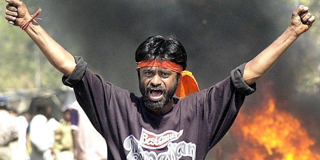 This famous photo from 2002 shows a Bajrang Dal activist who, years later, called the Gujarat riots