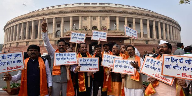 Shiv Sena MPs display placards while staging a protest during the Parliament Winter
