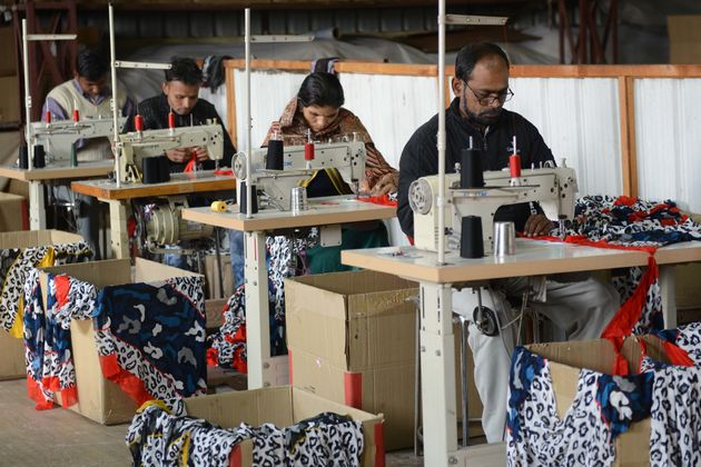 Tailors stitch stoles at a manufacturer ,on the outskirts of Amritsar on January 4,