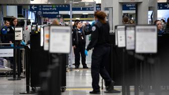 Transportation Security Administration agents check people through security at O'Hare International Airport Monday, Jan. 7, 2019, in Chicago. (Photo by Erin Hooley/Chicago Tribune/TNS/Sipa USA)