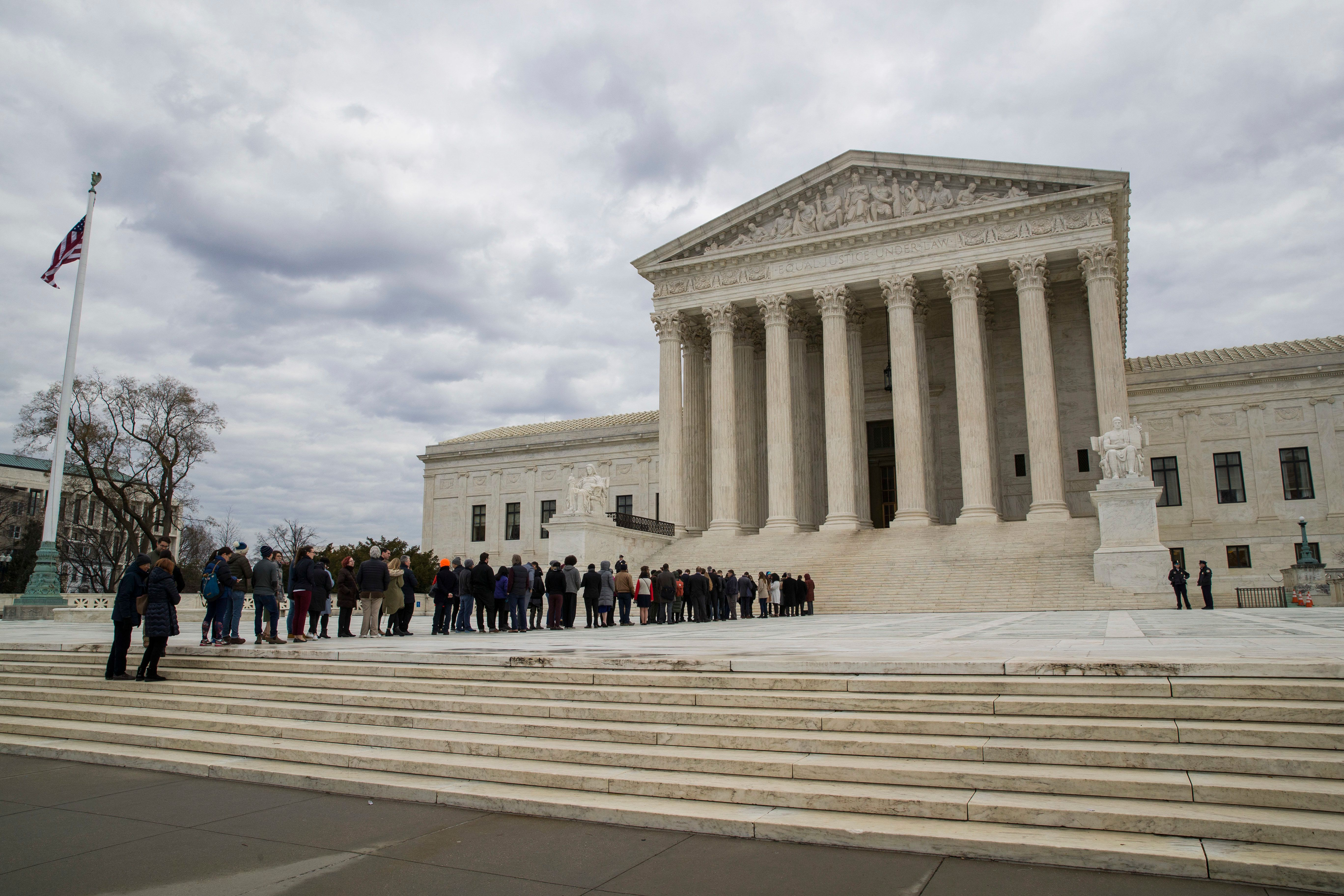 People wait in line to hear arguments before the Supreme Court, Tuesday, Jan. 8, 2019, in Washington. (AP Photo/Alex Brandon)