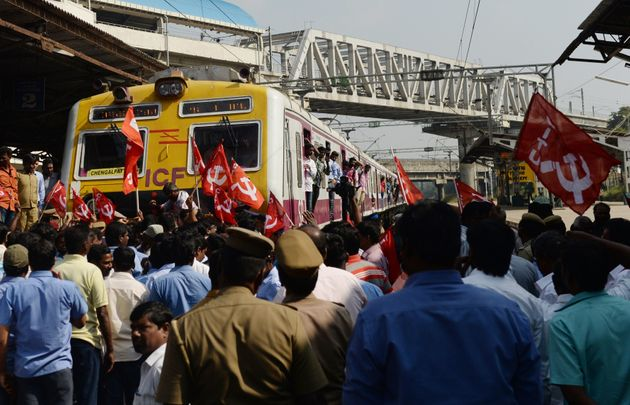 Members of the Centre of Indian Trade Unions (CITU) stop a train in Chennai during the nationwide