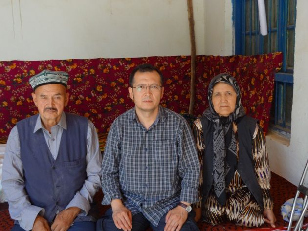 Aziz Isa Elkunwith his parents in his village of Toyboldi in Xinjiang province,
