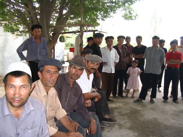 Elkun with fellow Uyghur villagers in Toyboldi, Shayar County, China. He fears his whole village has...