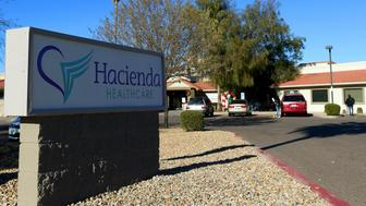 This Friday, Jan. 4, 2019, photo shows Hacienda HealthCare in Phoenix. The revelation that a Phoenix woman in a vegetative state recently gave birth has prompted Hacienda HealthCare CEO Bill Timmons to resign, putting a spotlight on the safety of long-term care settings for patients who are severely disabled or incapacitated. (AP Photo/Ross D. Franklin)