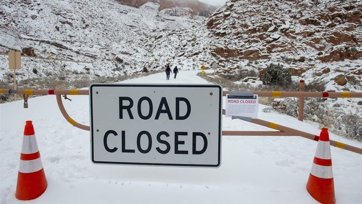 Visitors walk up the road in Arches National Park in Utah during the partial government shutdown. Some states have had to foo