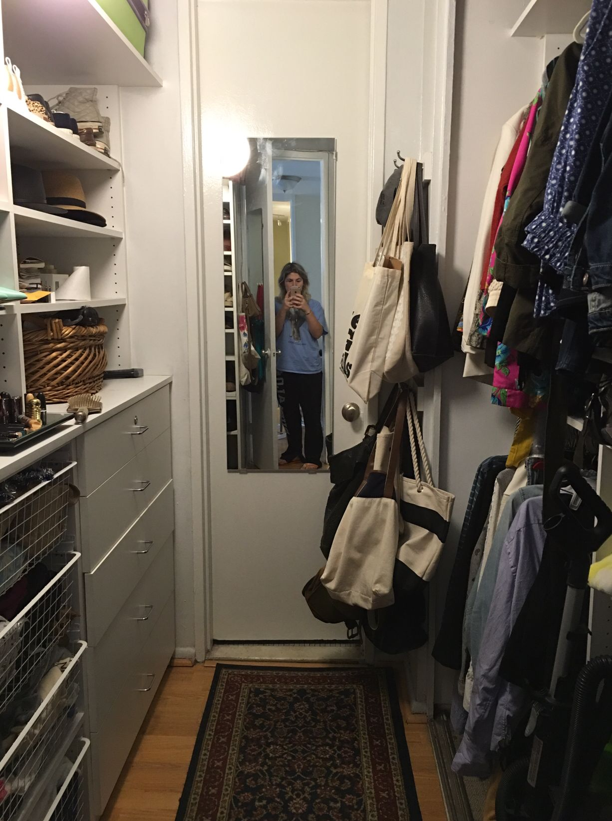 The author in her closet in 2016. Notice the amount of tote bags.