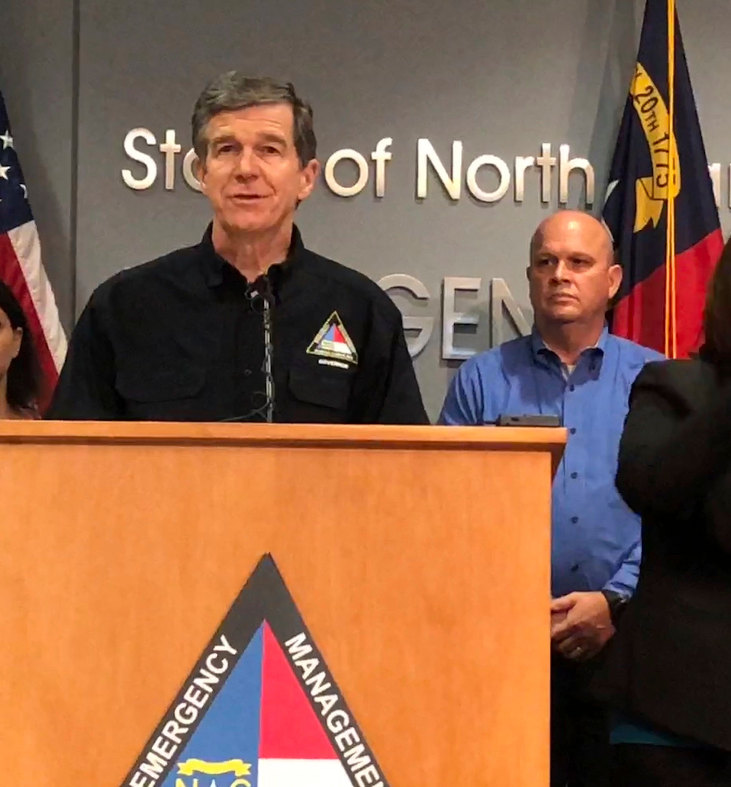 In this Sept. 12, 2018 photo, North Carolina Gov. Roy Cooper, left, speaks at a news conference about Hurricane Florence preparedness as attended by state Transportation Secretary Jim Trogdon, right, listens in Raleigh, N.C. Cooper has been praised by many, including Republicans, for his handling of the state's immediate response to Florence (AP Photo/Gary D. Robertson)