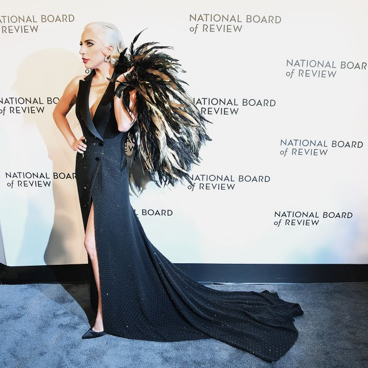 Gaga in a custom black tuxedo dress by Ralph Lauren. So, so dramatic.
