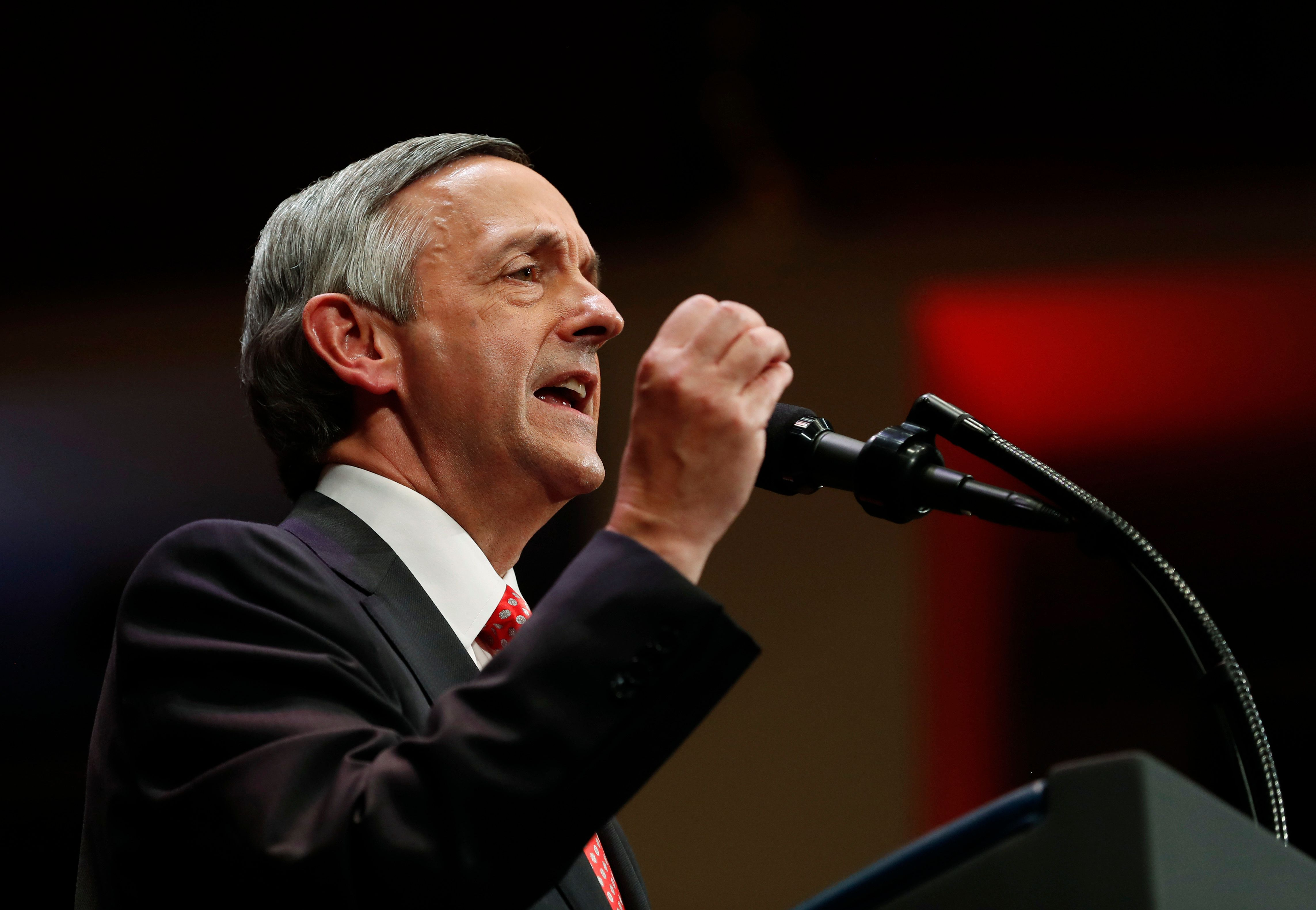 "FILE - In this July 1, 2017, file photo, pastor Robert Jeffress, of the First Baptist Church in Dallas, speaks as he introduces President Donald Trump during the Celebrate Freedom event at the Kennedy Center for the Performing Arts in Washington. In a tweet Sunday, May 13, 2018, Senate candidate Mitt Romney of Utah says the prominent Baptist minister, Jeffress, shouldn't be giving the prayer that opens the U.S. Embassy in Jerusalem because he's a ""religious bigot."" (AP Photo/Carolyn Kaster, File)"