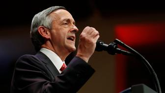 """FILE - In this July 1, 2017, file photo, pastor Robert Jeffress, of the First Baptist Church in Dallas, speaks as he introduces President Donald Trump during the Celebrate Freedom event at the Kennedy Center for the Performing Arts in Washington. In a tweet Sunday, May 13, 2018, Senate candidate Mitt Romney of Utah says the prominent Baptist minister, Jeffress, shouldn't be giving the prayer that opens the U.S. Embassy in Jerusalem because he's a """"religious bigot."""" (AP Photo/Carolyn Kaster, File)"""