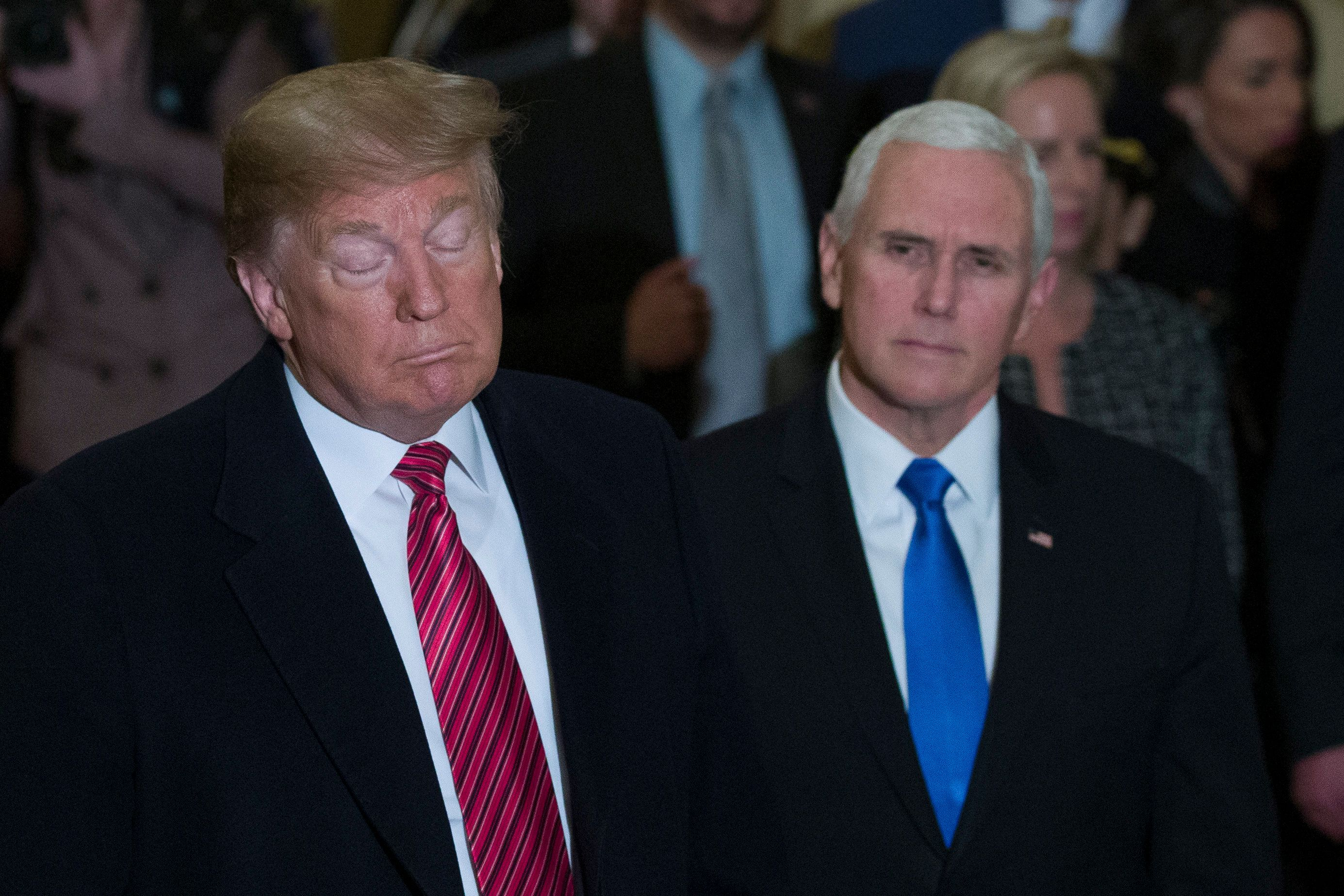 President Donald Trump, accompanied by Vice President Mike Pence, listens to a question as he arrives for a Senate Republican Policy luncheon, on Capitol Hill in Washington, Wednesday, Jan. 9, 2019. (AP Photo/Alex Brandon)