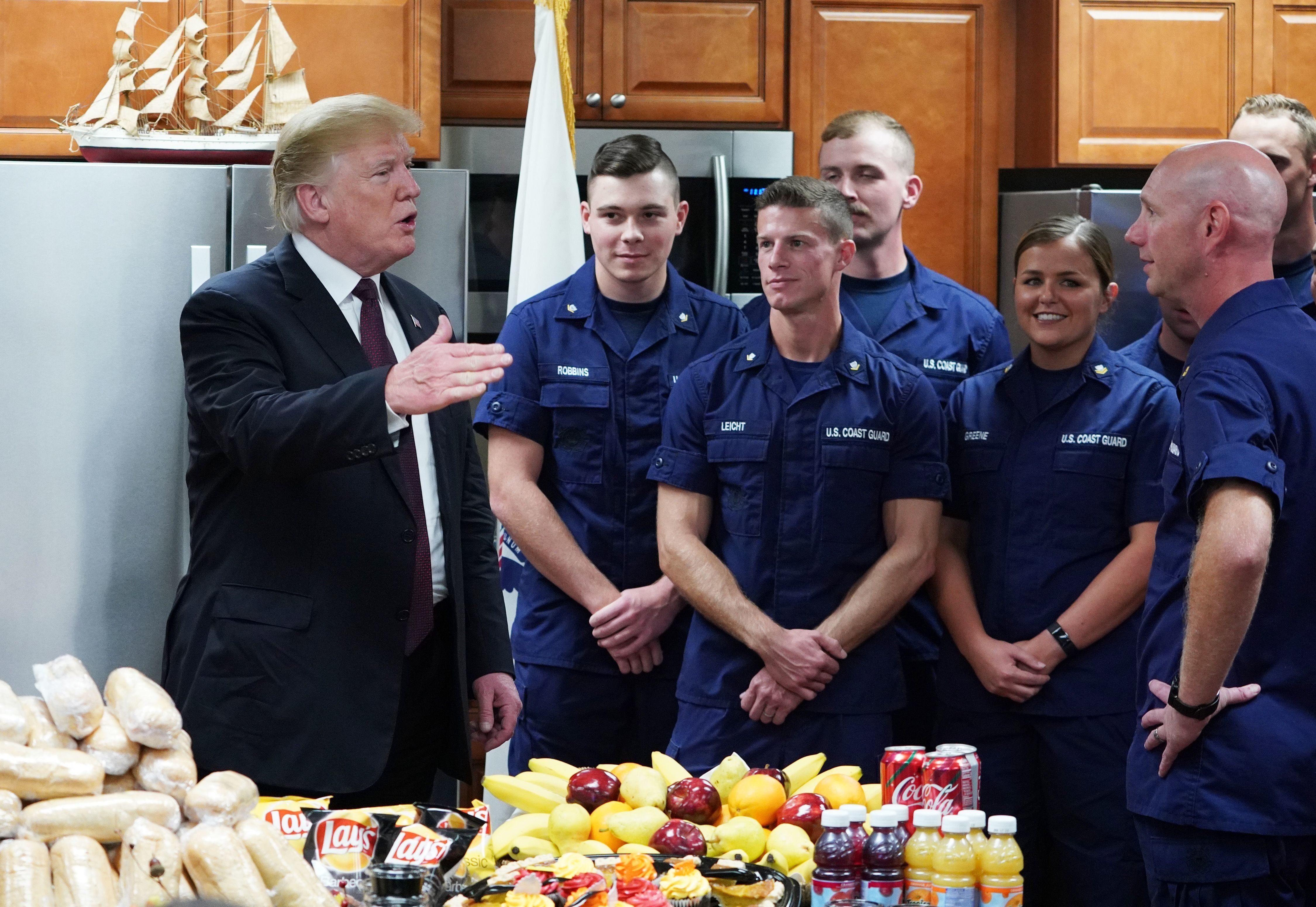 US President Donald Trump visits with personnel at US Coast Guard Station Lake Worth Inlet in Riviera Beach, Florida, on Thanksgiving Day, November 22, 2018. (Photo by MANDEL NGAN / AFP)        (Photo credit should read MANDEL NGAN/AFP/Getty Images)