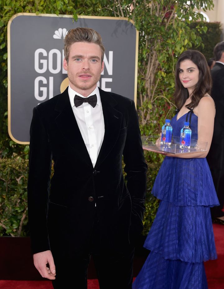 Model Kelleth Cuthbert became known as Fiji Water Girl after her expert photobombing at the Golden Globes took Twitter by storm. Here she shares a shot with Richard Madden.