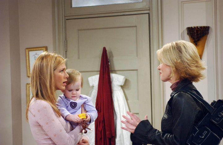 """Rachel (Jennifer Aniston) holds daughter Emma (Cali and Noelle Sheldon) as she talks to her sister Amy (Christina Applegate) in a 2003 episode of """"Friends."""""""