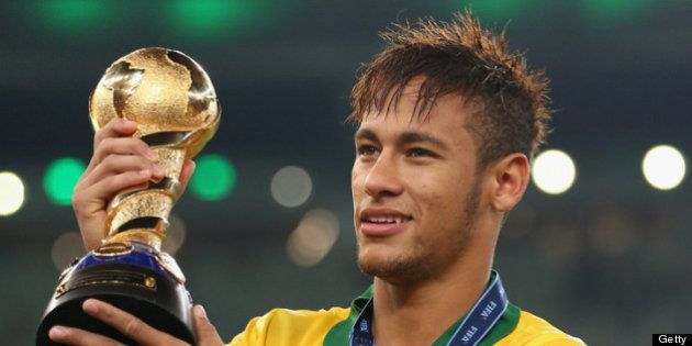 RIO DE JANEIRO, BRAZIL - JUNE 30: Neymar of Brazil holds the FIFA Confederations Cup trophy after the...