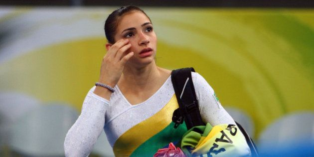 BEIJING - AUGUST 10: Lais Souza of Brazil walks off of the floor after competing the qualification round...
