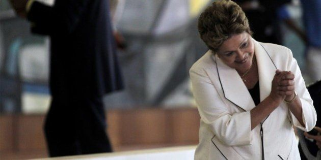 Brazilian President Dilma Rousseff waves after the inauguration ceremony of new ministers at Planalto...