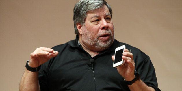 Steve Wozniak, co-founder of Apple Inc., holds an iPhone as he speaks at Hanyang University in Seoul,...