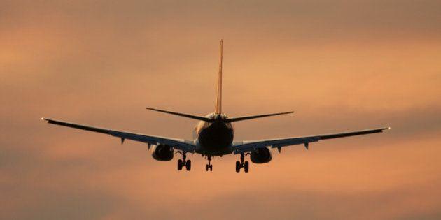 airliner against sunset