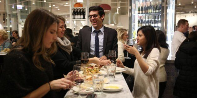 Diners sample the fare at La Piazza in Eataly Chicago, an Italian market with many eating options as...